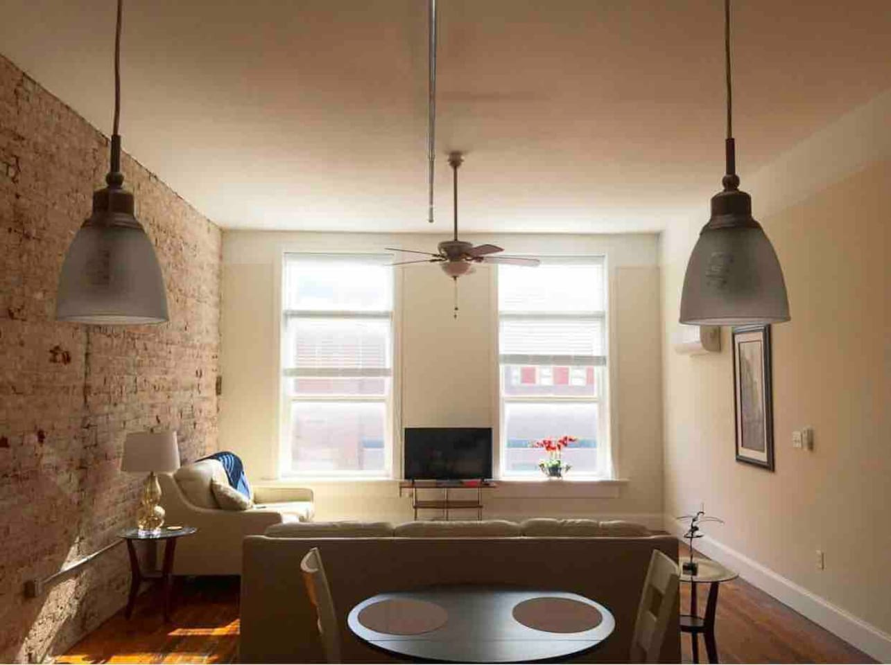 Open concept kitchen and living room overlooking Main St. Gorgeous light all day long, especially in the mornings!