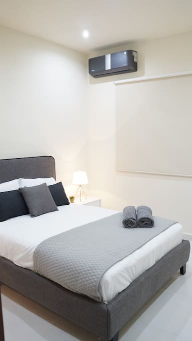 Second room with private bathroom, big closet, air conditioner, bed lamps, double size bed and towels