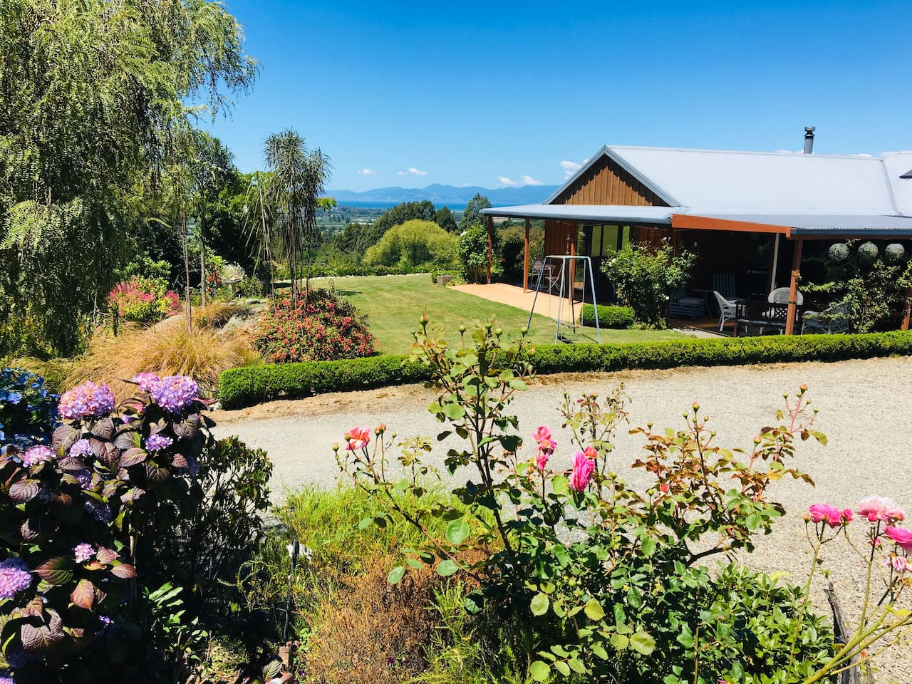 A quiet rural setting with expansive views from an elevated site overlooking rural plains of Riwaka and out across Tasman Bay. The suite is set within a private courtyard surrounded by colourful gardens