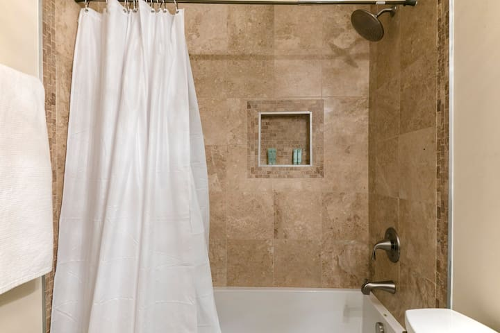 Bathroom #1 shower with spa style shower head and hotel style shampoo and conditioners