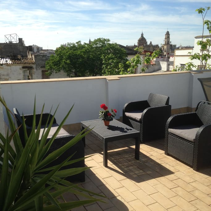 Comfortable lounge on terrace overlooking the city.