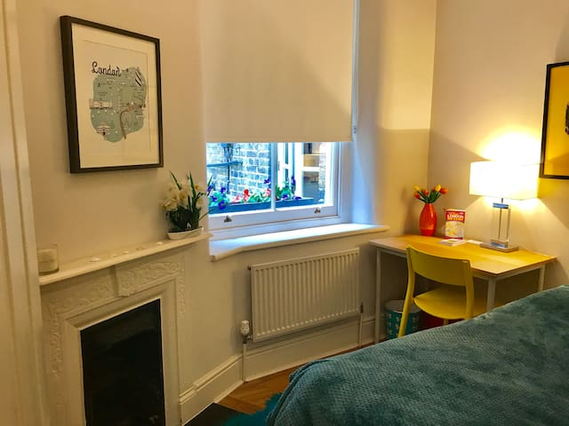 This is your room (see next picture for second half of it).   It's small and cosy but does the job! Your window looks onto our garden, not the street.   I'll provide a hairdryer and two clean towels. If you need anything else - just ask!