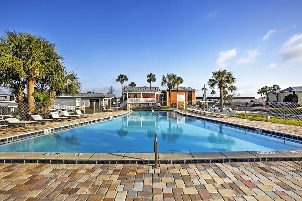 Soak up the sun by one of three the community pools.