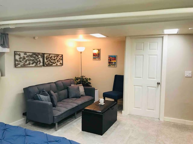 """Enjoy coffee on the futon sofa bed before a busy day in the city. Ottoman top flips over to be a coffee table, toys stored inside  Please note our ceiling height. Very tall (over 6'3"""") people may not be comfortable in our space."""