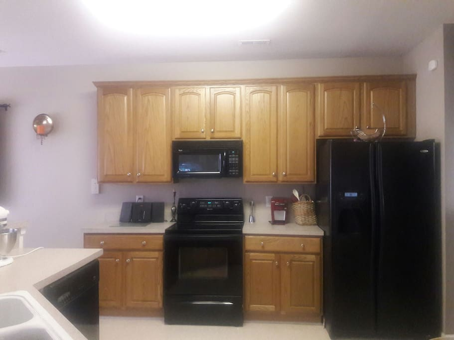 Kitchen equipped with everything you need to create meals and desserts; access to fridge, stove, microwave and 1-cup Keurig. Also has dishwasher for easy clean up