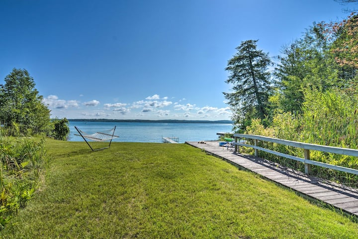 Torch Lake Home w/ 116 feet of Blue Water Access!
