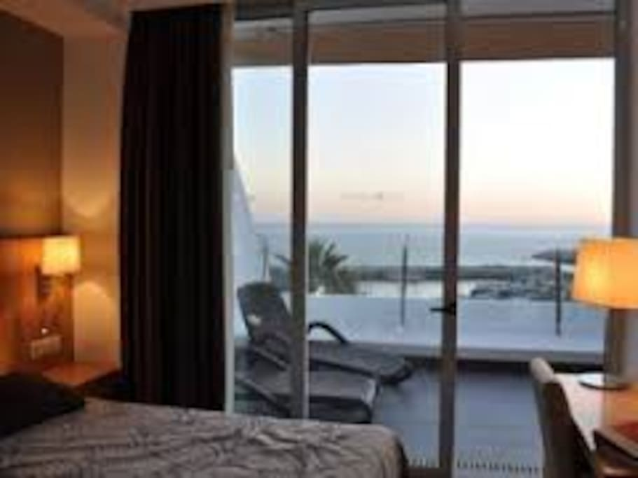 Sleeping room with a view to the harbor and the Atlantic