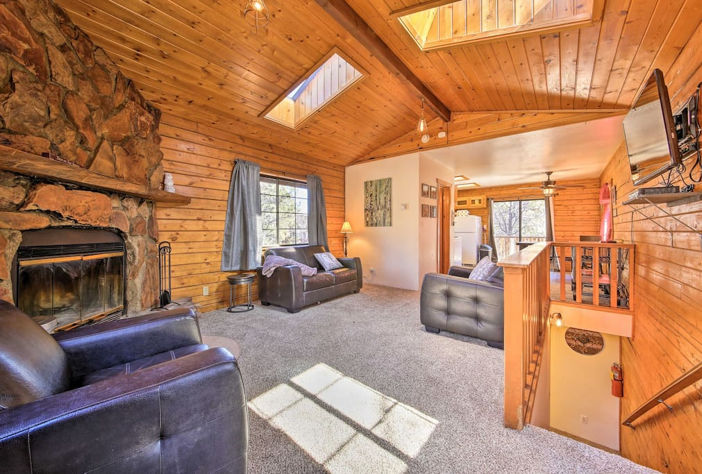 Wood beam ceilings and rustic decor create that classic cabin atmosphere in the living space.