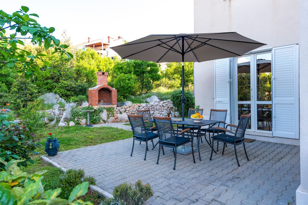 Outdoor area and BBQ in the background