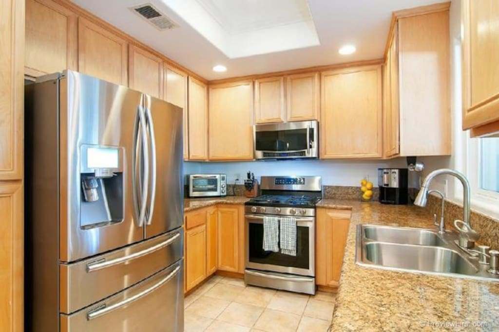 modern Kitchen with granite counter tops. Stainless apps.