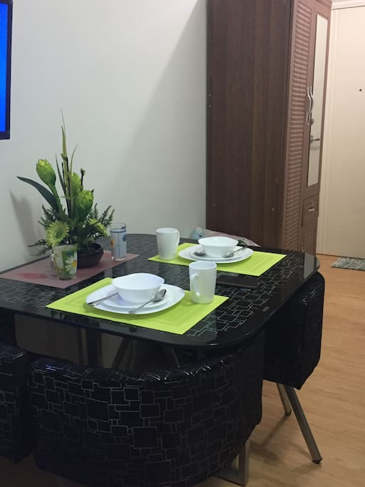 Entrance of condo unit with wardrobe n stylist dining area n Flat Screen TV
