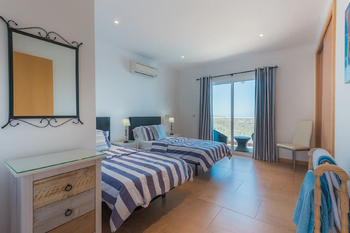 Bedroom 3 with Sea view and access to Pool Terrace