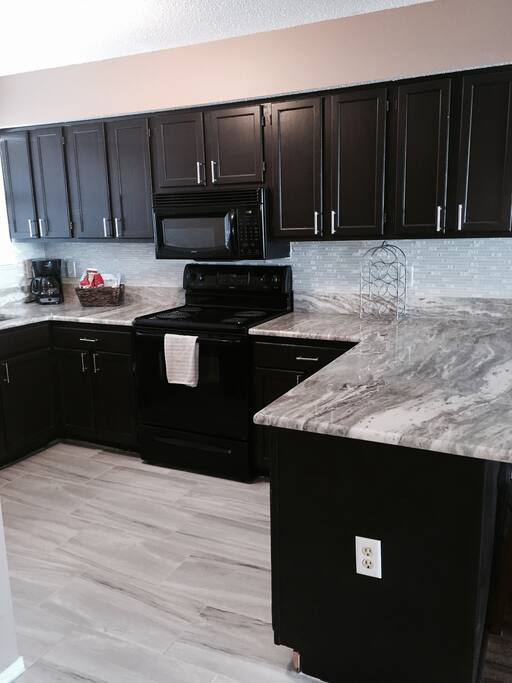 New granite and Tile in Kitchen