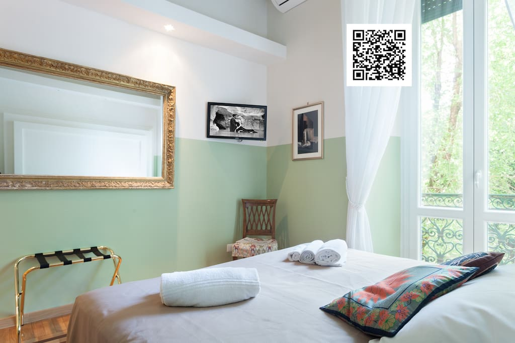 """""""Sinfonia room"""" with balcony and private ensuite bath.  Each room has private bath with shower, kettle, air drier, air conditioning, heating  shampoo soap towels linen. Wifi free. bar code shows you that this is a licensed b&b"""