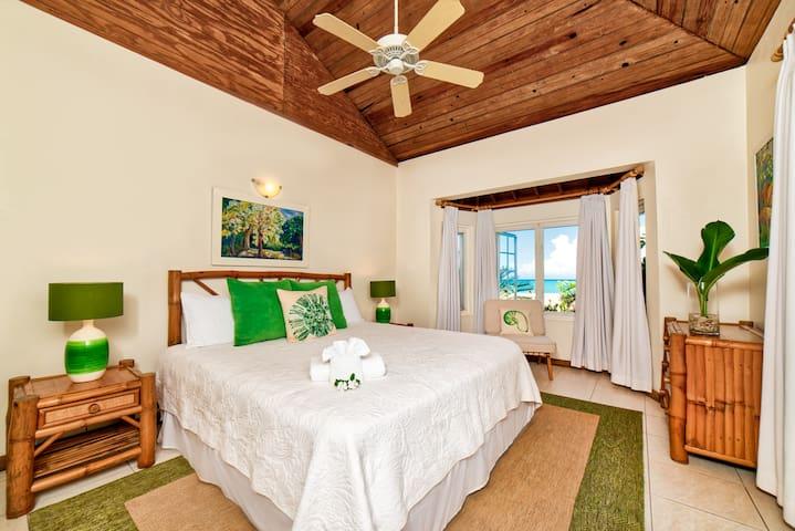 Bedroom #1      12x14 feet King bed, en suite bathroom, a/c, ceiling fan, bay windows, garden and turquoise Caribbean Sea views