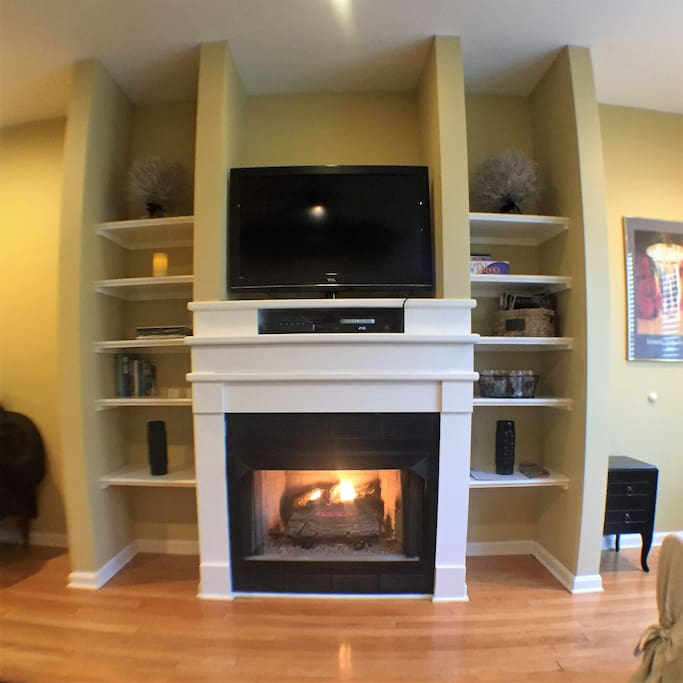 Cozy gas fireplace and TV on first floor.
