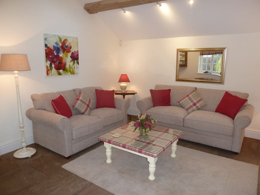 Cosy sitting room with sofa and sofabed