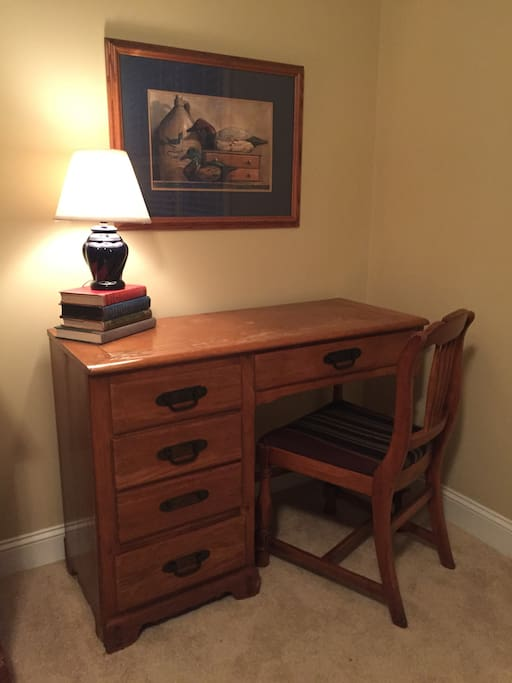 Desk with lamp, chair.