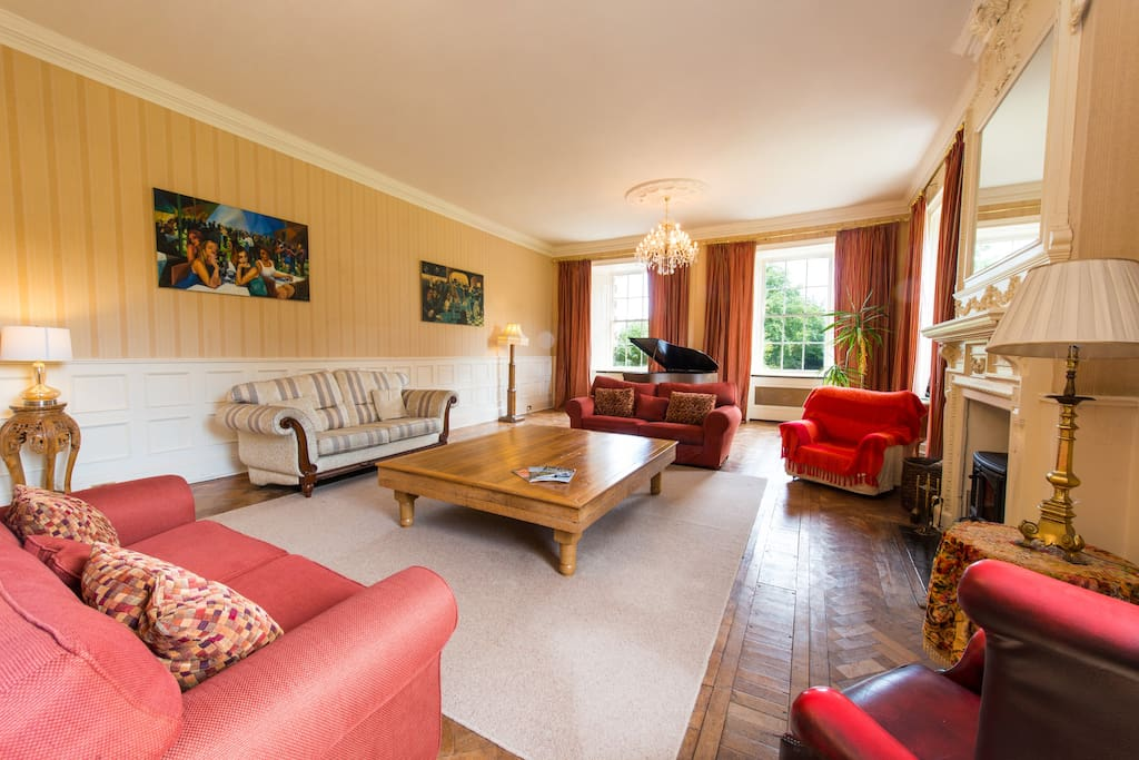 This is the main lounge looking East towards to the sea and South over the gardens.