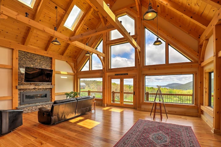 The cabin features stunning 28-foot cathedral ceilings with exposed wood beams.