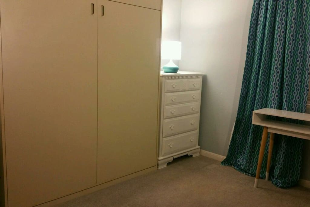 Murphy bed folds for daytime space