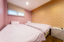 Two super single beds with private toilet