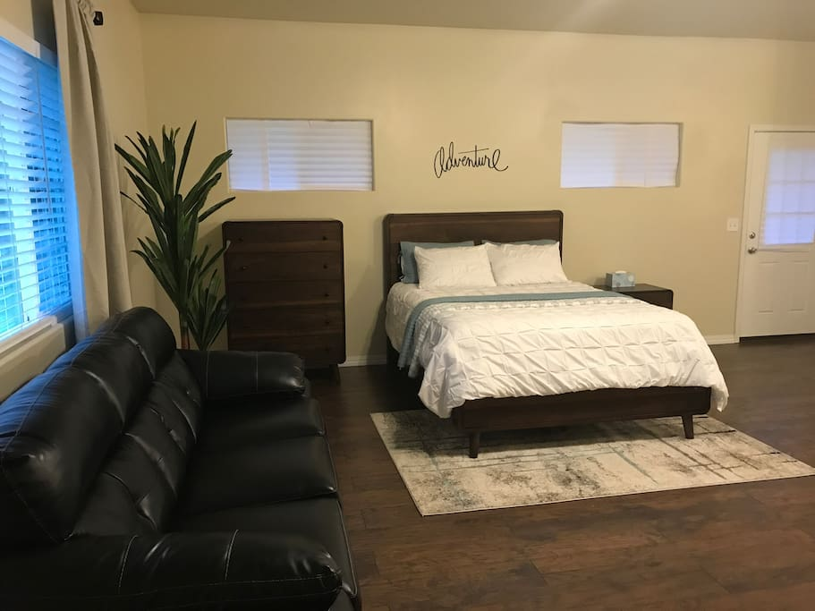 As you walk thru the front door, you will see the sleeper sofa and queen bed.