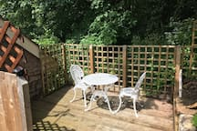 Private decking area complete with BBQ. Sit and listen to the brook down below - which is the physical border between England and Wales.