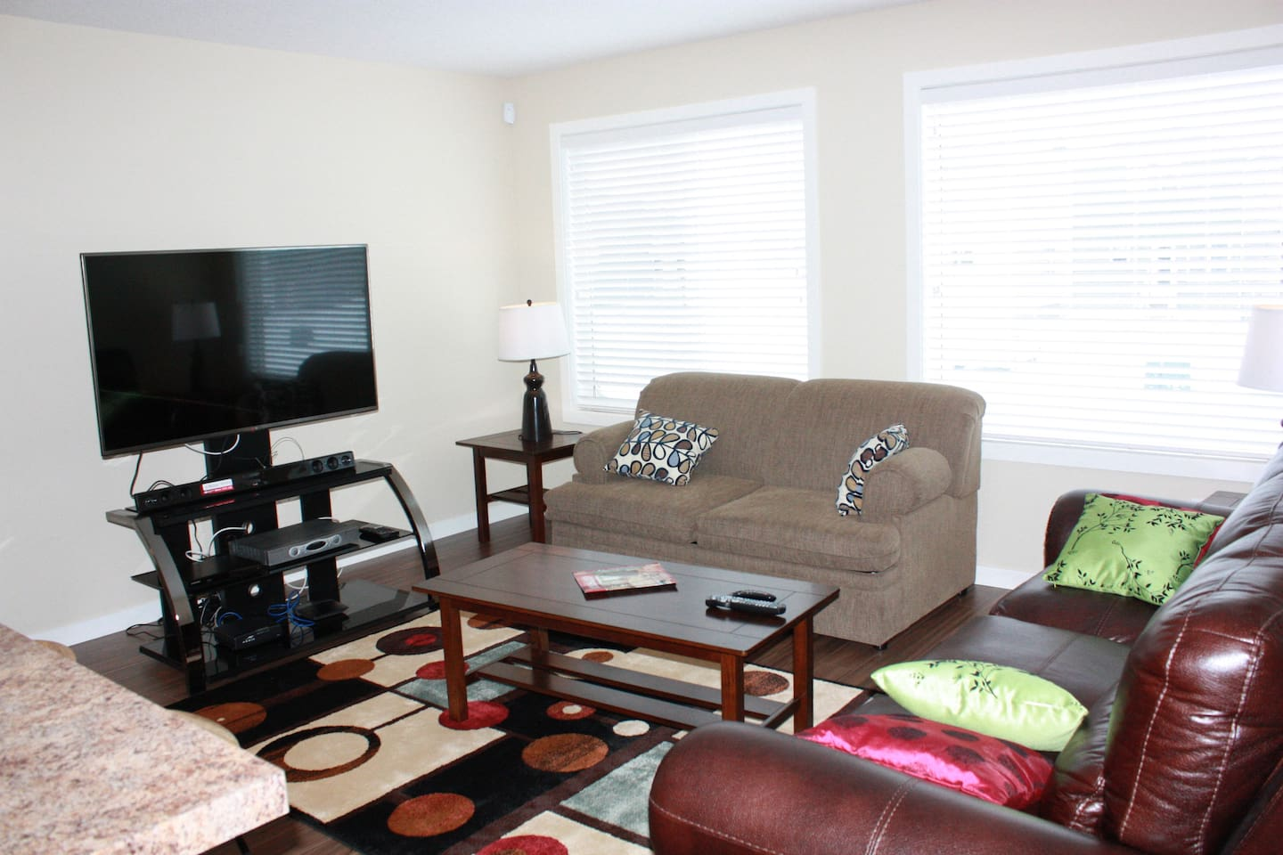 Well lit  Open concept living room with a Double Sofa bed
