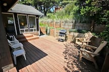 Large semi private back deck with gas BBQ, deck furniture and access into Queen bedroom.
