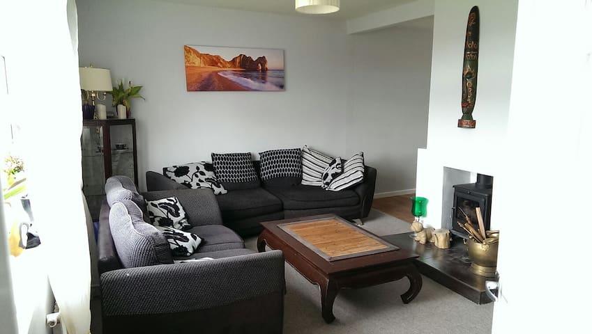 Room with a garden view,  fireplace &garden