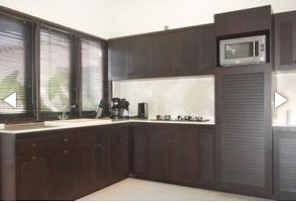 Kitchen outdoor with hot and cold water,microwave, rice cooker,refrigerator,water kettle, toaster,  blender.