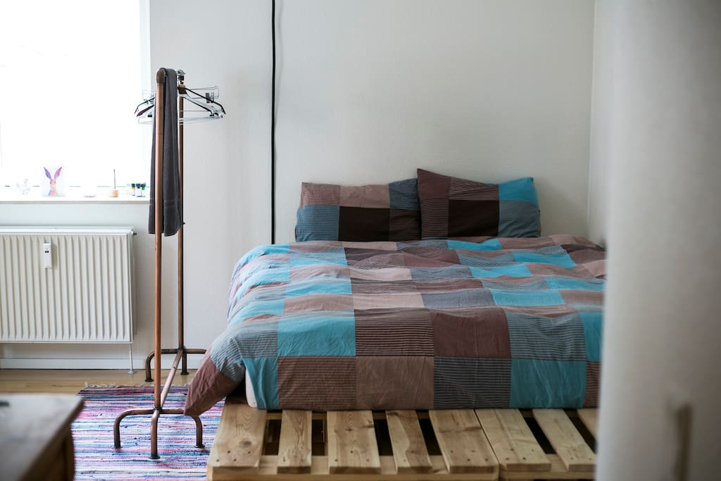Double bed made of pallets.