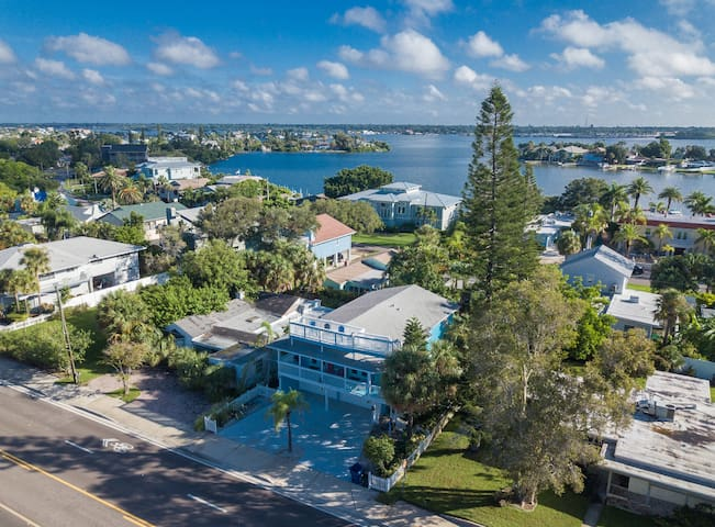 Drone view of our house with Boca Ciega Intercoastal Waterway behind