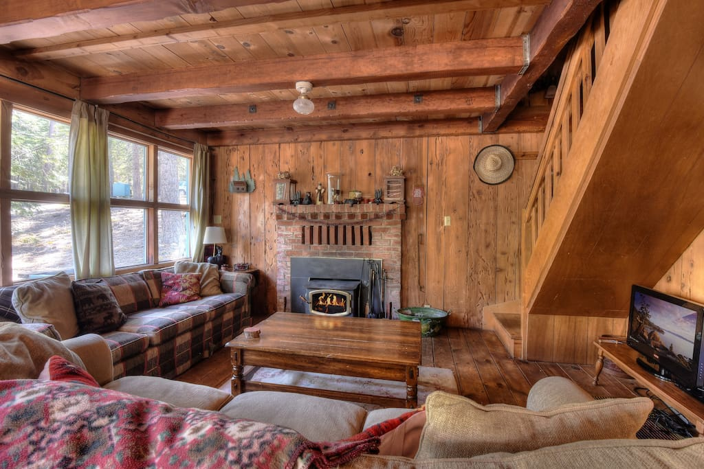 Warm living room with a wood burning fireplace