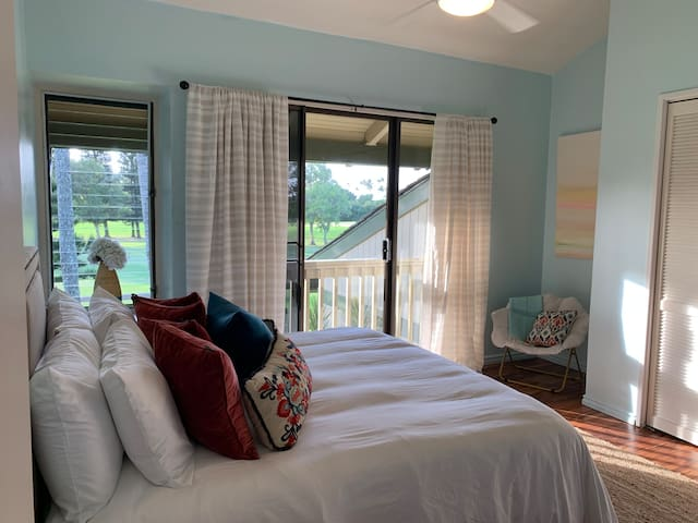 Master bedroom with King bed- new mattress and luxurious linens. Ceiling fan, air conditioner and beautiful view.  Attached bathroom with shower.