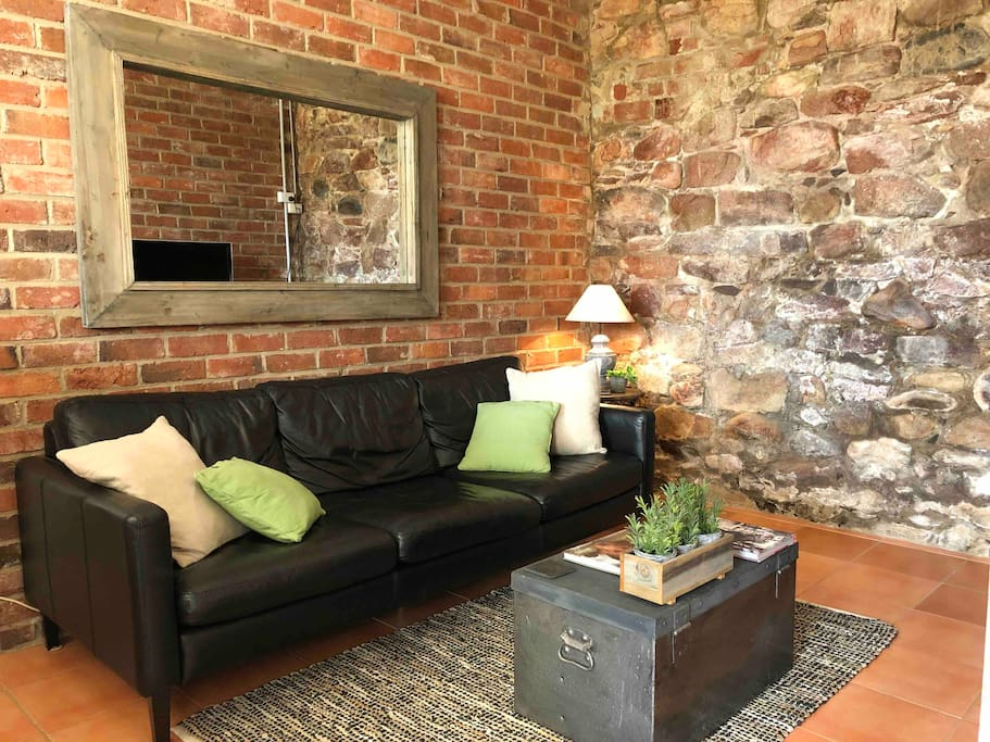 Lounge with soft leather couch to relax and watch TV or read one of our many Australian history books