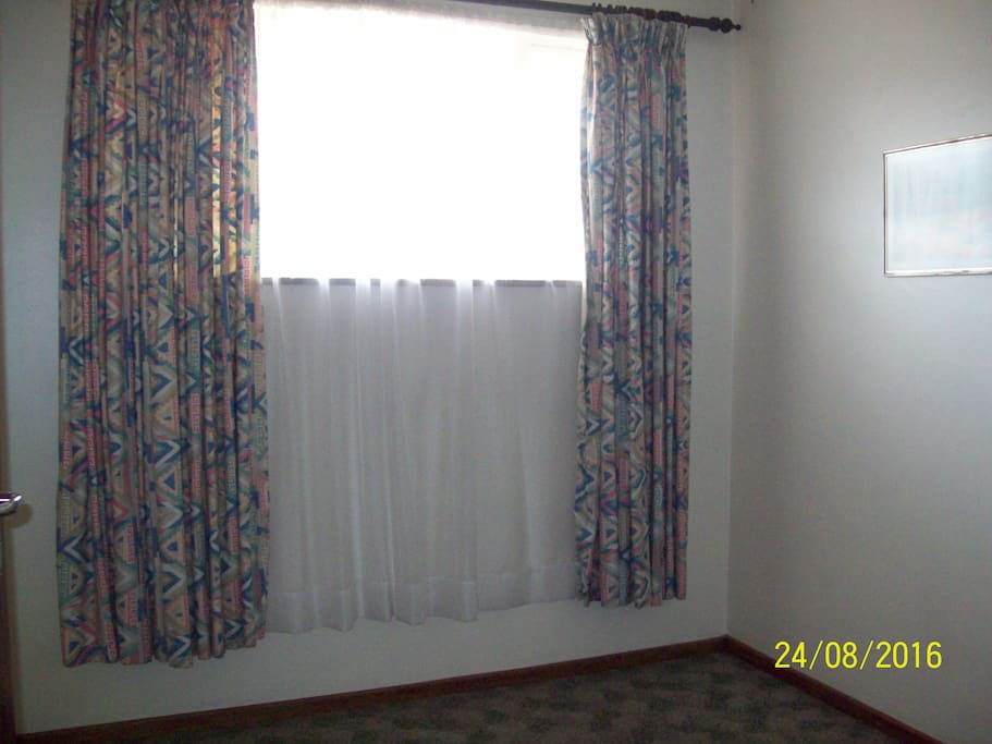 View of the window area in bedroom.