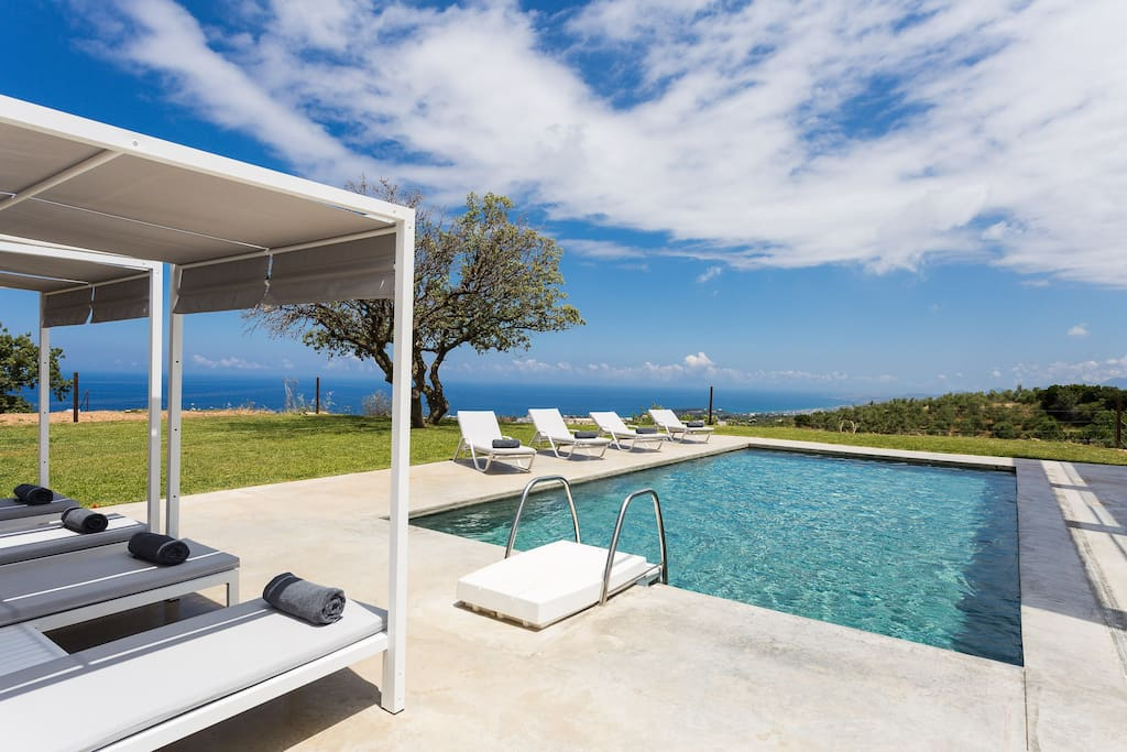 50 sq. m swimming pool surrounded by sun beds & gazebo beds.