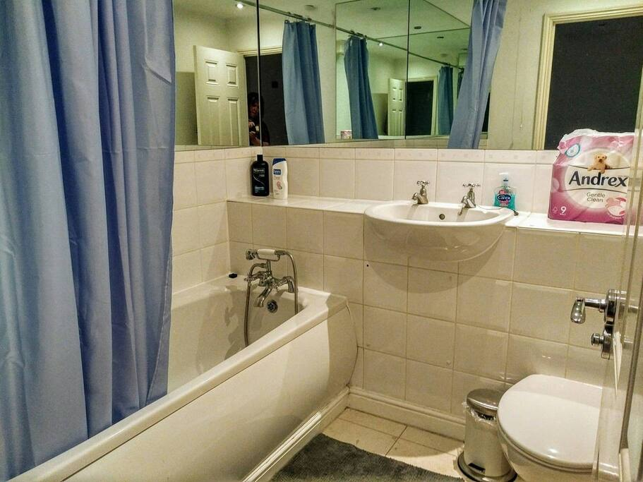 Bathroom with toilet, sink, bathroom and hand held shower – shared with other 1-2 guests