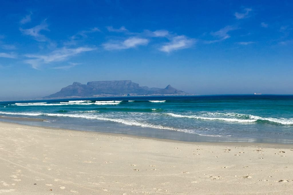 Enjoy a walk on the beach and get the most amazing shots of Table Mountain.