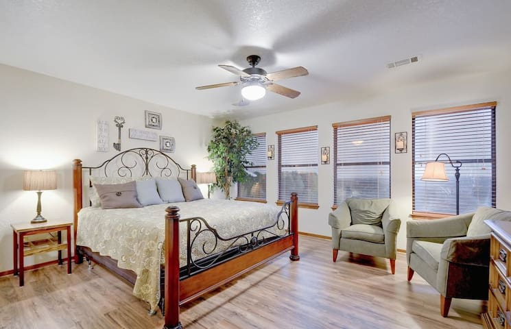 Master King Bed in this generous bedroom with two reading chairs. As the only room upstairs, it offers maximum peace and privacy