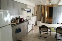 Kitchen and dining room with curtained off washing machine and dryer
