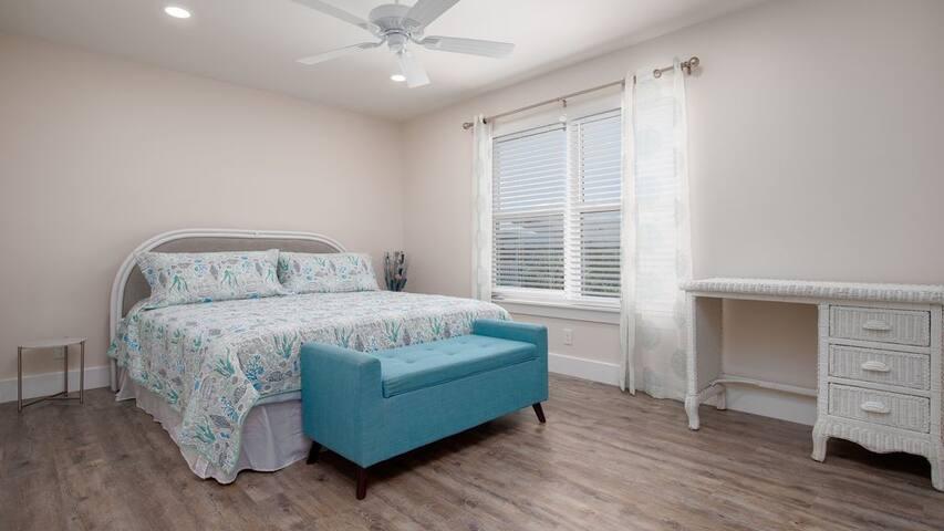 Master bedroom with bench blanket storage.