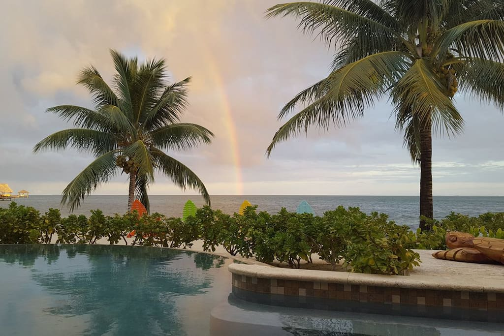 Rainbow dipping into the ocean
