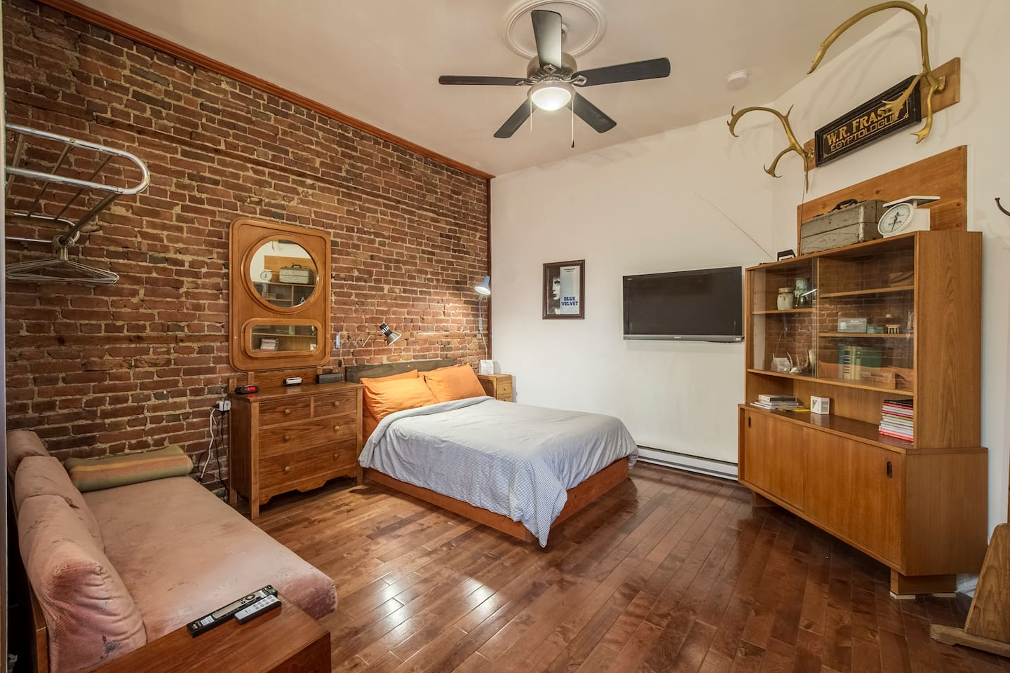 studio with full sized bed, tv (netflix included!) luggage/clothing rack, bluetooth speaker and couch