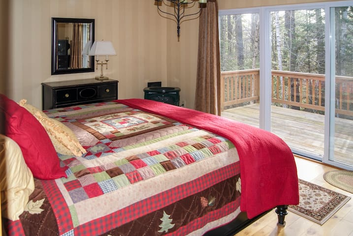Master bedroom with king bed and gas fireplace