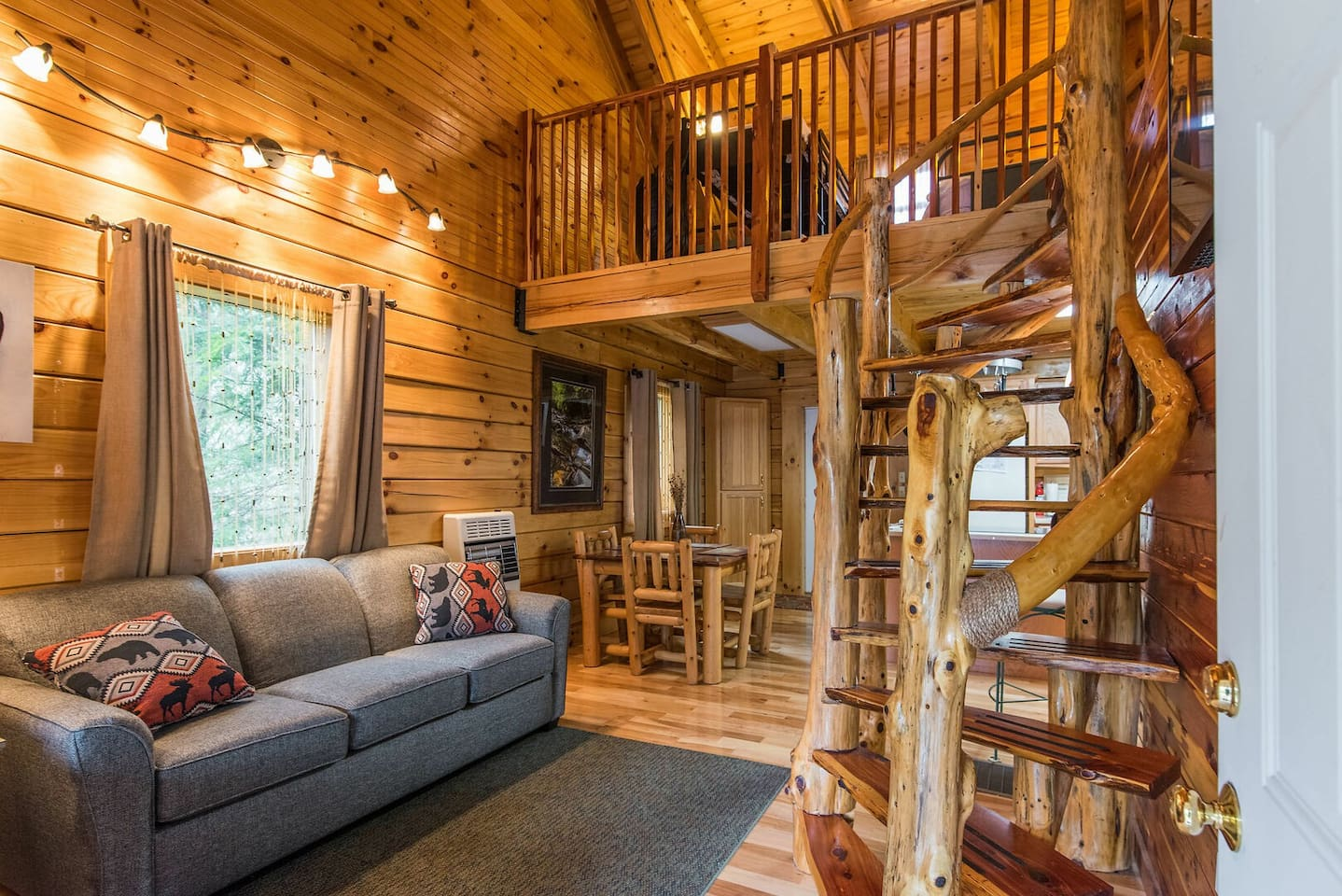 This is another view of the hand-crafted cedar staircase connected to the living room and kitchen