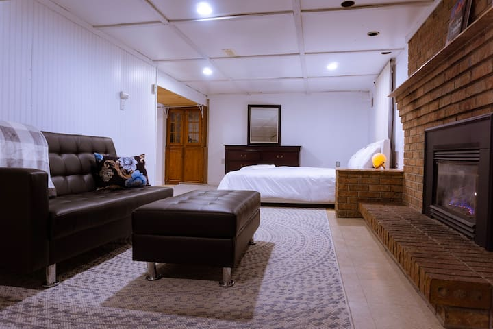 View of living area and bed from kitchenette