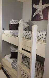 Bunk beds steps from the beach!